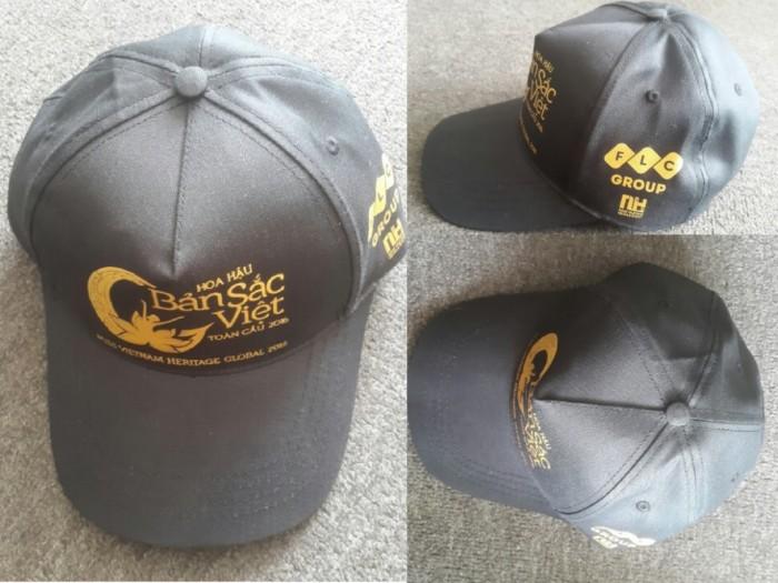 Nón đồng phục sự kiện | NÓN BẢN SẮC VIỆT TOÀN CẦU | Chất liệu: nón may từ kaki cao cấp | Kiểu nón: nón kết đen in logo nhủ đồng trước nón và bên hông nón | Màu sắc: đen in nhủ đồng