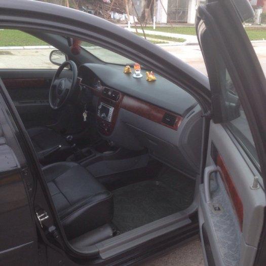 Gia đình cần bán xe Daewoo lacetti đời 2009, màu đen, biển hà nội 4 số. 4