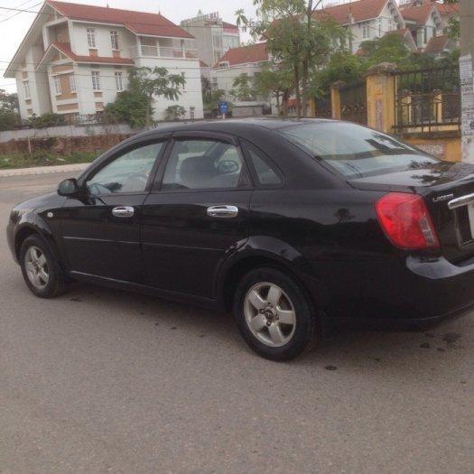 Gia đình cần bán xe Daewoo lacetti đời 2009, màu đen, biển hà nội 4 số. 5