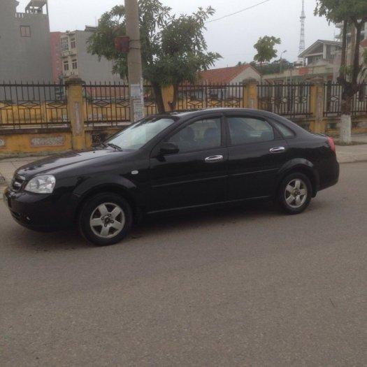 Gia đình cần bán xe Daewoo lacetti đời 2009, màu đen, biển hà nội 4 số. 12