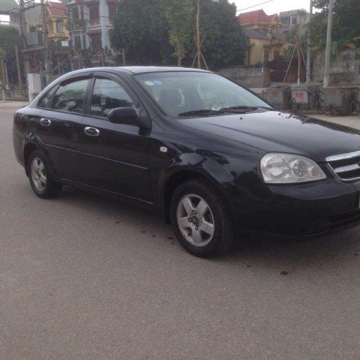 Gia đình cần bán xe Daewoo lacetti đời 2009, màu đen, biển hà nội 4 số. 13