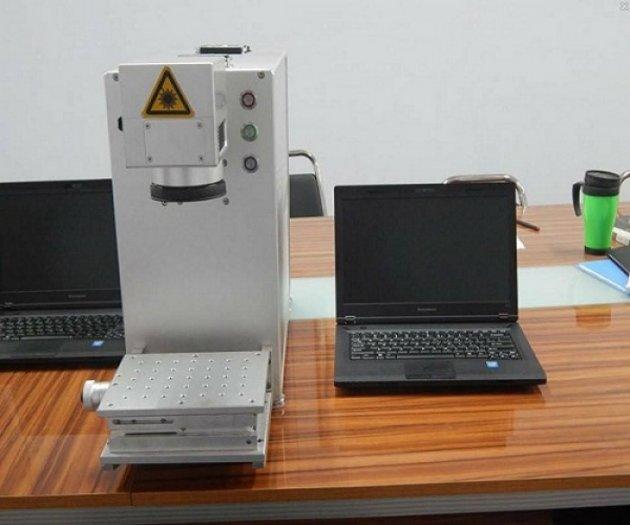 Máy laser fiber khắc kim loại như logo, nhãn mác…giá rẻ...0