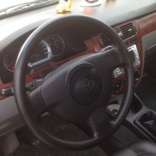 Gia đình cần bán xe Daewoo lacetti đời 2009, màu đen, biển Hà Nội 0