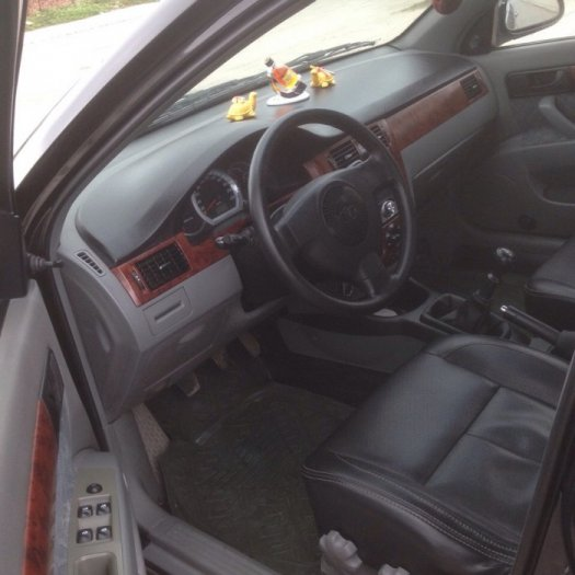 Gia đình cần bán xe Daewoo lacetti đời 2009, màu đen, biển Hà Nội 2