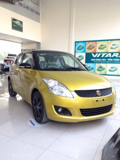 Bán xe Suzuki Swift RS mầu vàng chóe!