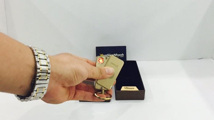 Hộp quẹt điện Dinuo mạ vàng 24k kiêm móc khóa sang trọng.