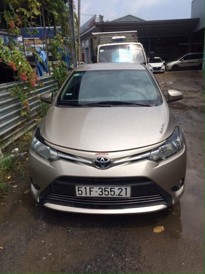 Bán Toyota Vios E 2015 số sàn màu vàng cát biển Sài Gòn