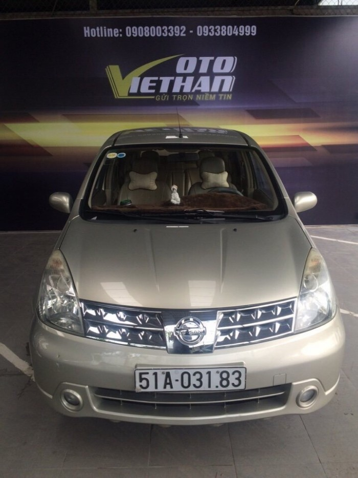 Bán Nissan Grand Livina 7 chỗ số sàn 2010 màu vàng cát biển SG 5