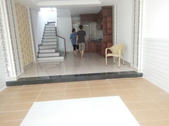 Nhà mặt tiền đường Hoàng Quốc Việt 4 phòng ngủ mới 100%