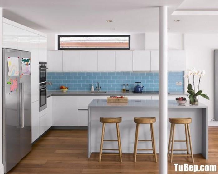 Tủ bếp chữ L chất liệu Acrylic bóng gương kết hợp bàn đảo – TBN0036 + Chất liệu và xuất xứ: Chất liệu Acrylic EU + Màu sắc và đặc tính: trắng  + Hình dạng kích thước:Tủ bếp được thiết kế dạng chữ L theo phong cách hiện đại + Loại nhà và diện tích đặt bếp: Căn hộ gia đình, không gian phòng khoảng 20m2 + Dịch vụ cộng thêm: thiết kế miễn phí, theo dõi tiến độ online, tem chứng nhận, sms theo dõi bảo hành, bảo trì 24/7