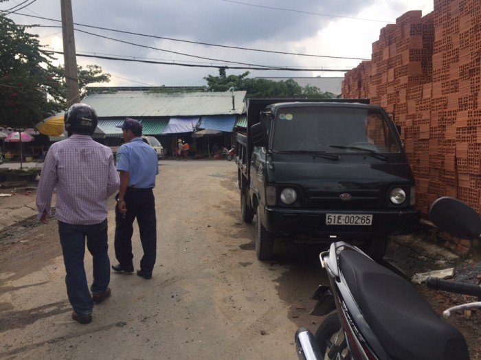 Cần bán gấp lô đất thổ cư nằm mặt tiền chợ Phú Thuận, Quận 7,DT 12x25m.
