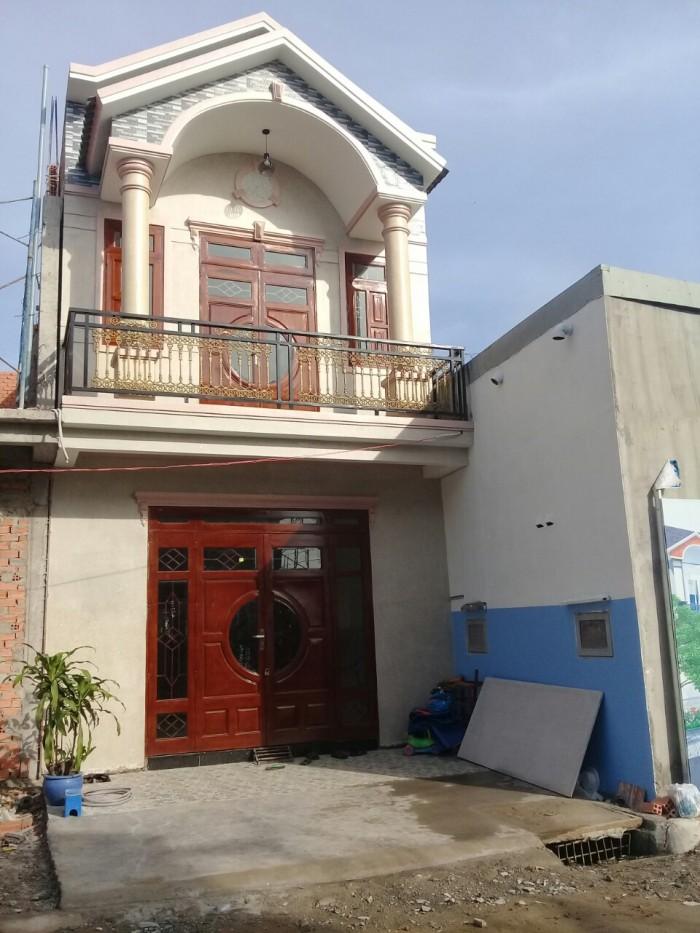 Bán nhà gấp 1 trệt 1 lầu mớI xây gần chợ