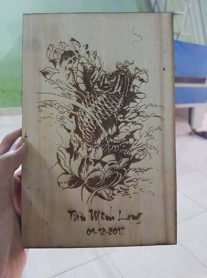 Sản phẩm khắc chân dung lên gỗ5