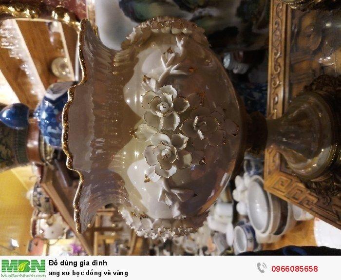 Ang sư bọc đồng vẽ vàng