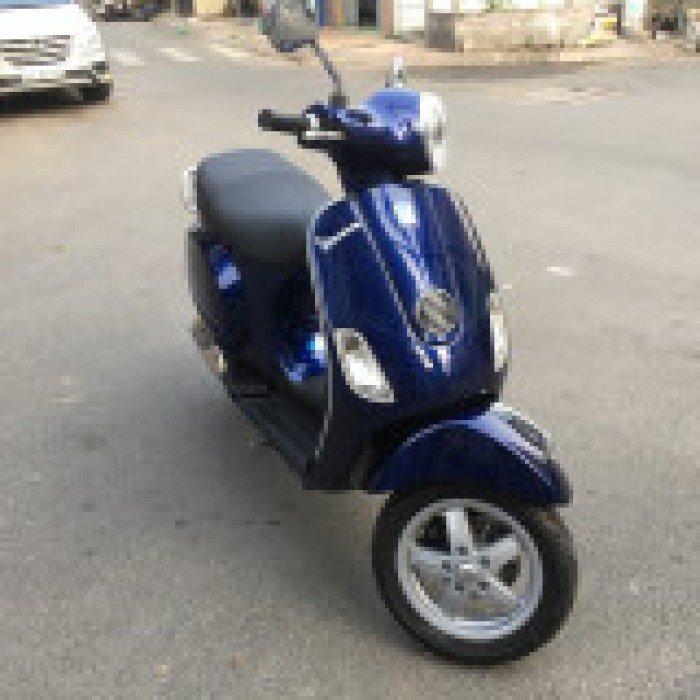 Vespa LX ie mua 2013 mẫu Scooter cổ điển,mới 99%