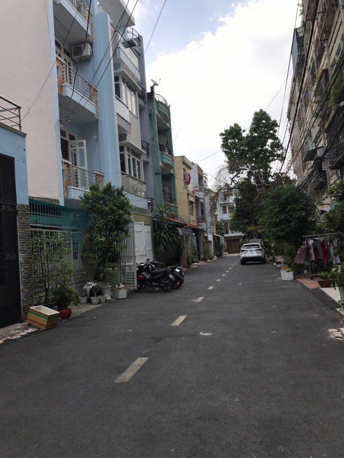 Nhà 2 mặt tiền 2 hẻm xe hơi đường Gò Dầu sát chung cư, có công viên nội bộ.