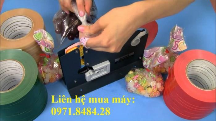 Máy buộc túi nilong, máy buộc túi trong siêu thị, máy buộc túi thực phẩm1