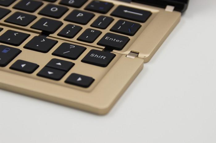 Bàn phím Bluetooth kiêm giá đỡ cho iPad, máy tính bảng0