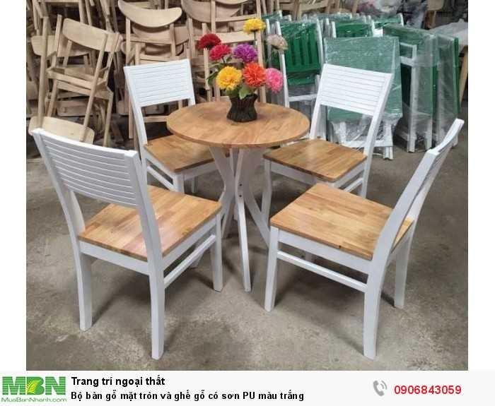 Bộ bàn gỗ mặt tròn và ghế gỗ có sơn PU màu trắng0