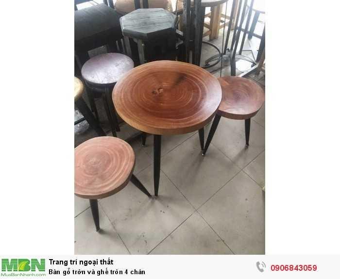 Bàn gỗ trờn và ghế tròn 4 chân0