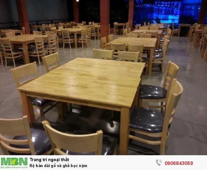 Bộ bàn dài gỗ và ghế bọc nệm0