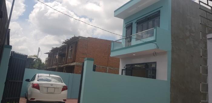 Nhà mới xây 2 tầng rất đẹp, có sân đậu ô tô đường Lương Định Của, Vĩnh Ngọc cách Chợ Chiều chỉ 50m.