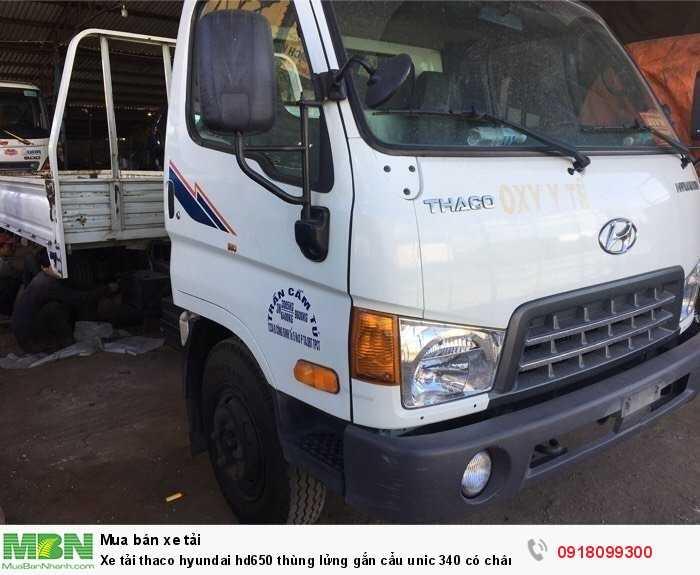 Xe tải thaco hyundai hd650 thùng lửng gắn cẩu unic 340 có chân sau 1