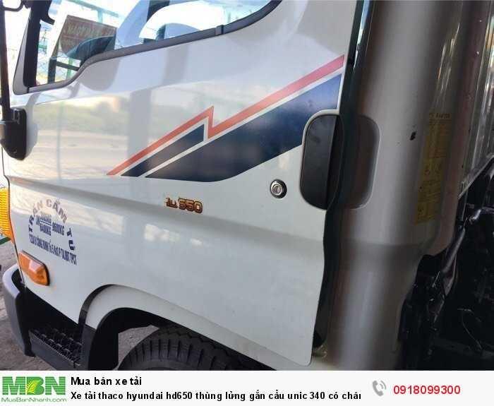 Xe tải thaco hyundai hd650 thùng lửng gắn cẩu unic 340 có chân sau 2