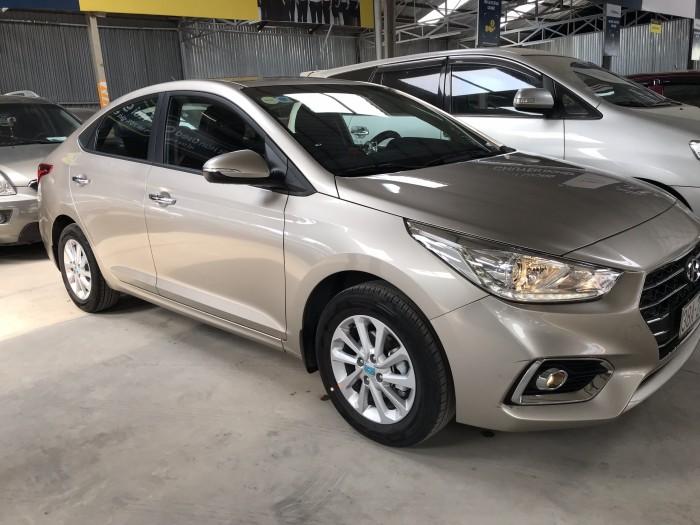 Bán Hyundai Accent 1.4MT màu vàng cát số sàn sản xuất cuối 2018 bản đủ options đi 1.900km