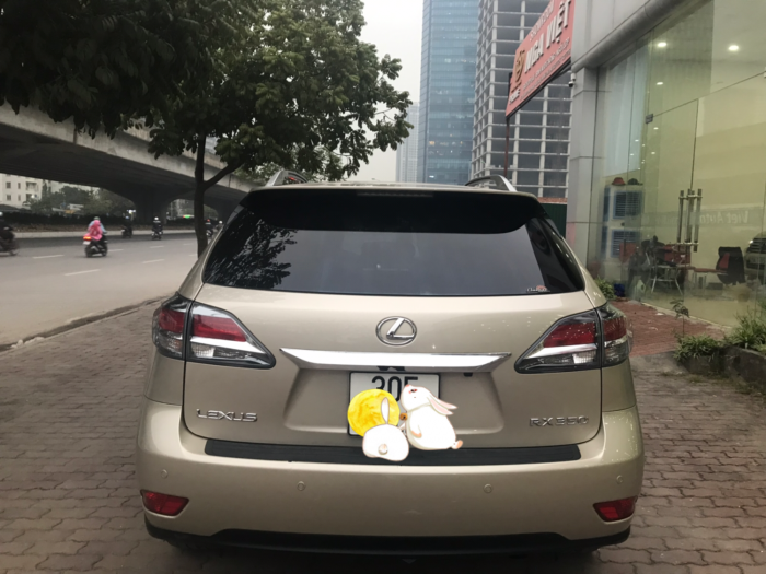 Bán Lexus RX350 màu vàng,sản xuất và đký 2014,biển Hà Nội ,lăn bánh 1,2 vạn km,như mới ,xe như mới tinh