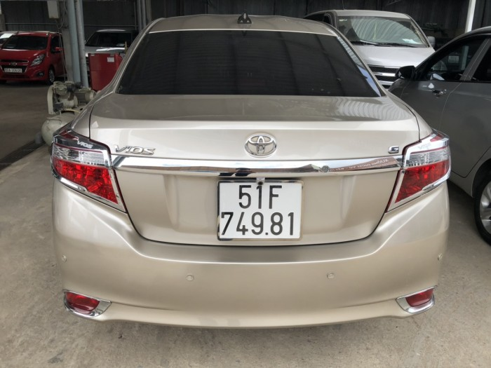 Bán Toyota Vios G 1.5AT màu vàng cát số tự động sản xuất 2016 biển Sài Gòn 1 chủ