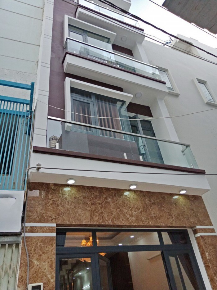Bán nhà mới 3 lầu hẻm xe hơi Lý Phục Man P. Bình Thuận Quận 7.