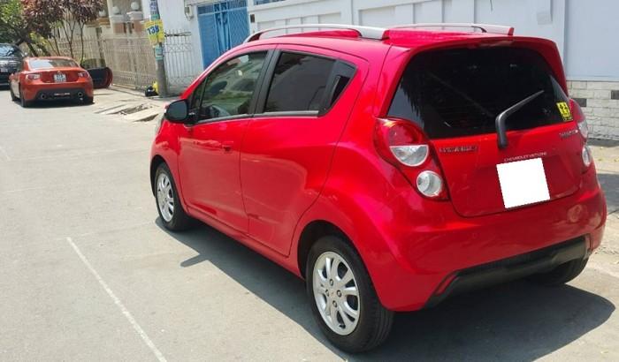 Nhà cần bán xe Spark 2015, bản LTZ, số tự động màu đỏ