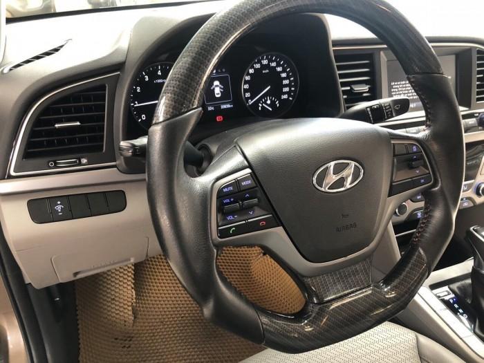 Bán Hyundai Elantra GLS 1.6AT màu nâu titan số tự động sản xuất 2016 biển Bình Dương đi 33000km