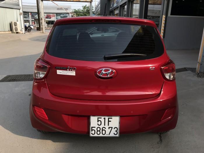 Bán Hyundai Grand i10 1.2AT HB màu đỏ số tự động nhập Ấn Độ 2015 biển Sài Gòn đi 24000km