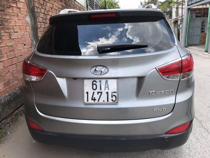 Bán Hyundai Tucson 4WD 2.0AT màu xám số tự động nhập Hàn Quốc 2011 biển Bình Dương