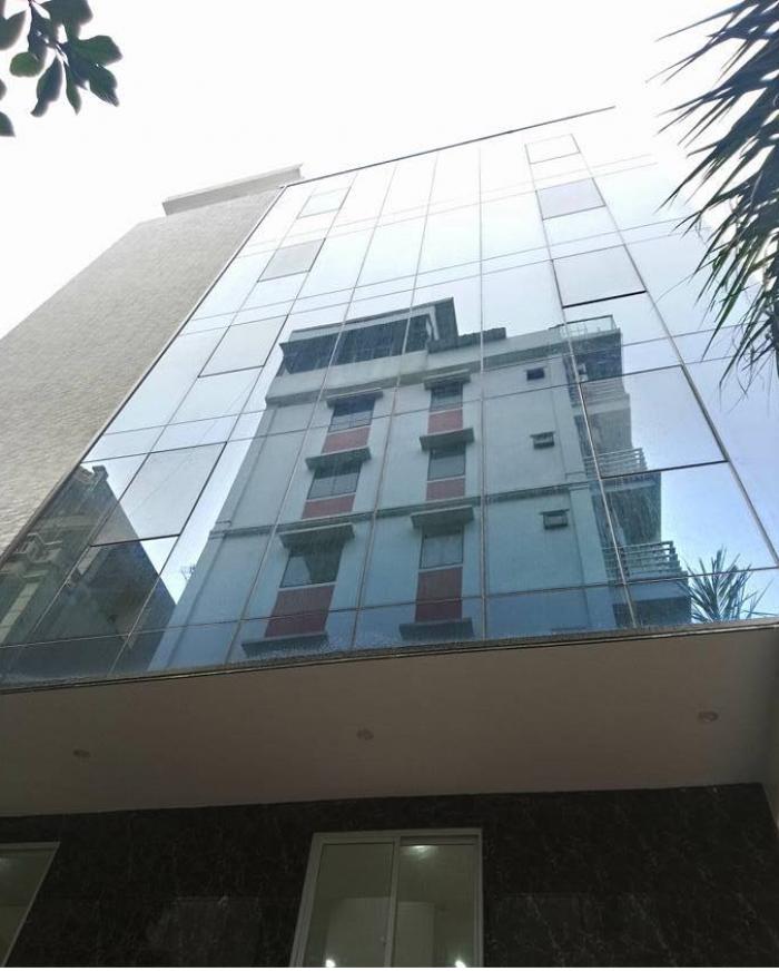 Bán nhà Tây Sơn 81m2* 8 tầng thang máy, gara 2 ô tô, KD, VP, Spa