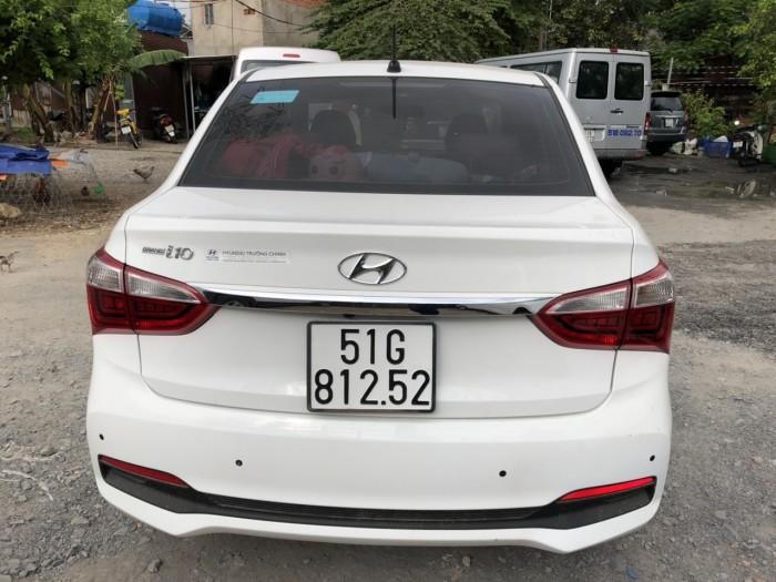 Bán Hyundai Grand i10 sedan 1.2MT màu trắng số sàn bản đủ biển Sài Gòn sản xuất cuối 2018 đi 10.000km