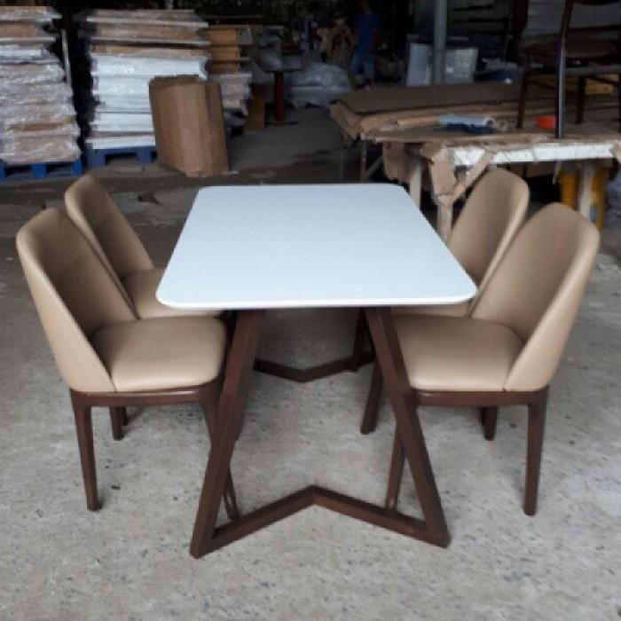 Bộ bàn ăn mặt nệm chân gổ cao su làm tại  xưởng sản xuất anh khoa 550