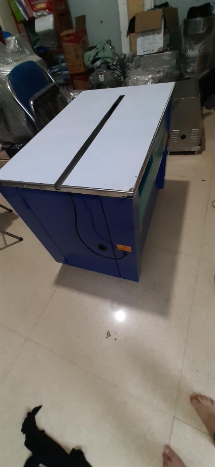 Máy đóng đai thùng carton, máy đóng đai thùng khẩu trang ý tê1
