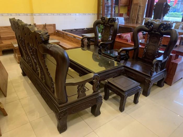Bộ bàn ghế cột 12 gỗ chiu iu chạm đào phong thủy1