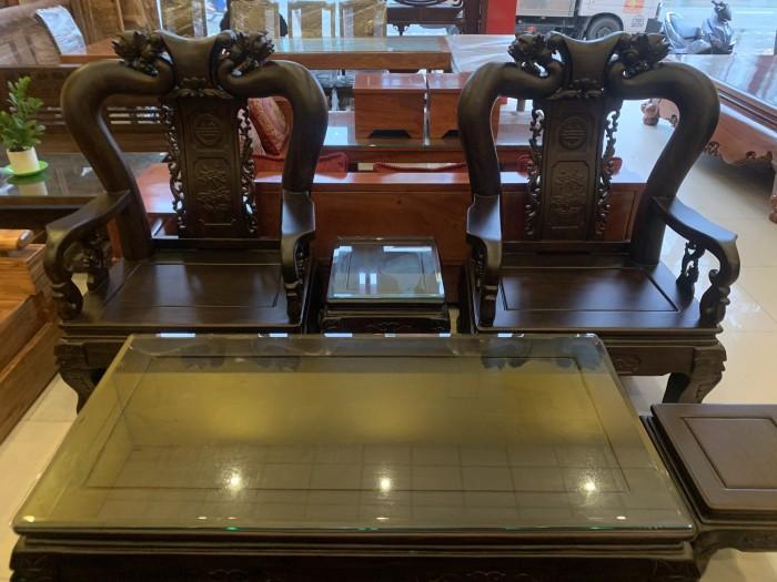 Bộ bàn ghế cột 12 gỗ chiu iu chạm đào phong thủy3