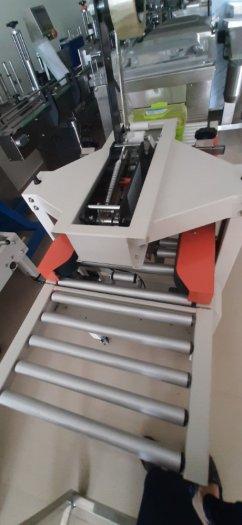 Máy dán thùng, máy dán băng dính, máy dán thùng mặt trên mặt dưới, máy dán thùng bán tự động FXA60502