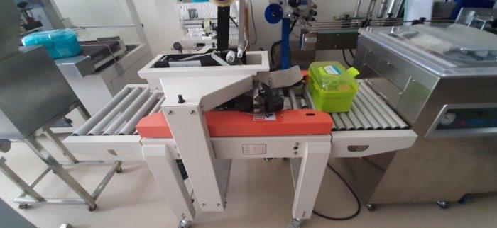 Máy dán thùng, máy dán băng dính, máy dán thùng mặt trên mặt dưới, máy dán thùng bán tự động FXA60501