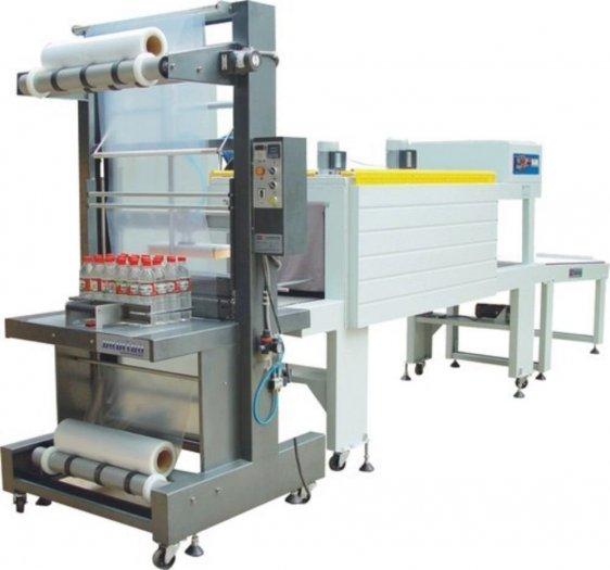 Máy cắt dán và co màng lốc chai bán tự động1