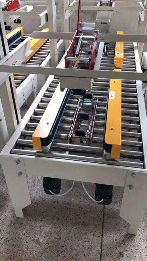 Máy dán băng dính thùng carton 2 mặt bán tự động1