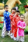 Áo dài trẻ em gấm thái tuấn màu hồng xu lá trúc cho bé gái