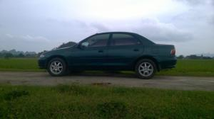 Cần bán xe mazda323 đời 1998