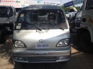 Xe tải 1t24, hiệu tmt, thùng lửng, màu trắng
