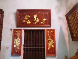 Bộ tranh Cửu Ngư Quần Hội và cặp tranh Cá Chép ngậm Trăng dát vàng 9999